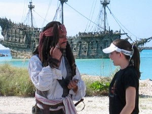 Captain Jack Sparrow Posing With The Flying Dutchman