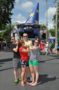 Family Picture in front of Sorerer's Hat in Disney's Hollywood Studios